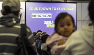 FILE - In this March 31, 2014 file photo, a screen shows a countdown for the deadline to sign up for health insurance during an enrollment event in Commerce, Calif.  Despite recently announced federal figures showing 8 million Americans signing up for subsidized private care, the law has only chipped away at one of its core goals to reduce the number of people without insurance. (AP Photo/Ringo H.W. Chiu, File)