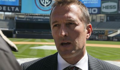 New York City Football Club soccer head coach Jason Kreis, answers questions on the field at New York's Yankee Stadium,  Monday, April 21, 2014.  The Yankees announced that Yankee Stadium will serve as the Club's first home and begin play on March 2015. (AP Photo/Richard Drew)