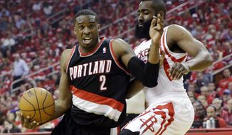 Portland Trail Blazers' Wesley Matthews (2) tries to drive past Houston Rockets' James Harden during the first half in Game 1 of an opening-round NBA basketball playoff series, Sunday, April 20, 2014, in Houston. (AP Photo/David J. Phillip)
