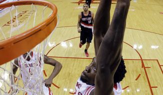 Houston Rockets' Patrick Beverley goes up for a dunks during the first half in Game 1 of an opening-round NBA basketball playoff series against the Portland Trail Blazers, Sunday, April 20, 2014, in Houston. (AP Photo/David J. Phillip)