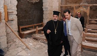 "In this photo taken on Sunday, April 20, 2014, and released on the official Facebook page of the Syrian Presidency, Syrian President Bashar Assad, right, checks a damaged church during his visit to the Christian village of Maaloula, near Damascus, Syria. Assad visited on Sunday a historic Christian village his forces recently captured from rebels, state media said, as the country's Greek Orthodox Patriarch vowed that Christians in the war-ravaged country ""will not submit and yield"" to extremists. The rebels, including fighters from the al-Qaida-affiliated Nusra Front, took Maaloula several times late last year. (AP Photo/Syrian Presidency via Facebook)"