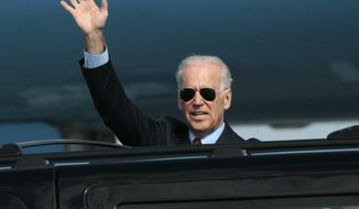 U.S. Vice President Joe Biden waves as he arrives at Borispol airport outside Kiev, Ukraine on Monday April 21, 2014. Vice President Joe Biden on Monday launched a high-profile visit to demonstrate the U.S. commitment to Ukraine and push for urgent implementation of an international agreement aimed at de-escalating tensions even as violence continues. Biden planned to meet Tuesday with government leaders who took over after pro-Russia Ukrainian President Viktor Yanukovych was ousted in February following months of protests. The White House said President Barack Obama and Biden agreed he should make the two-day visit to the capital city to send a high-level signal of support for reform efforts being pushed the new government. (AP Photo/Sergei Chuzavkov)