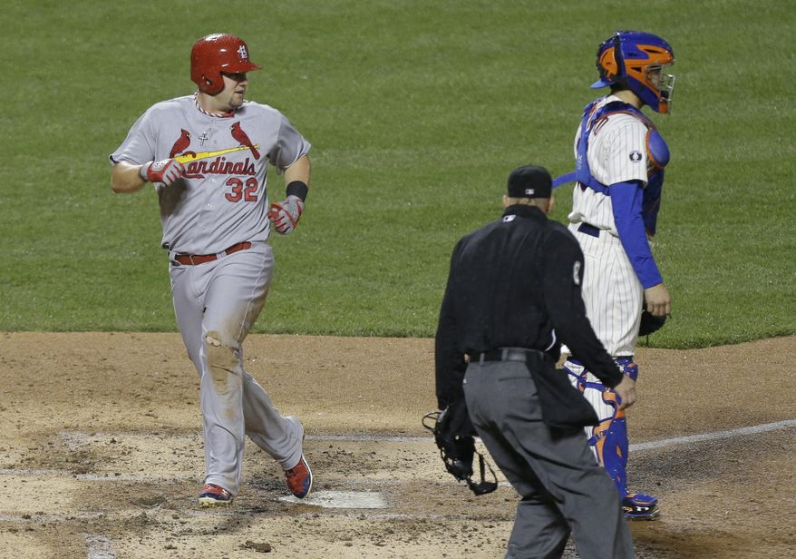 St. Louis Cardinals' Matt Adams (32) scored on an two run single by teammate Jon Jay during the fourth inning of a baseball game against the New York Mets Tuesday, April 22, 2014, in New York. (AP Photo/Frank Franklin II)