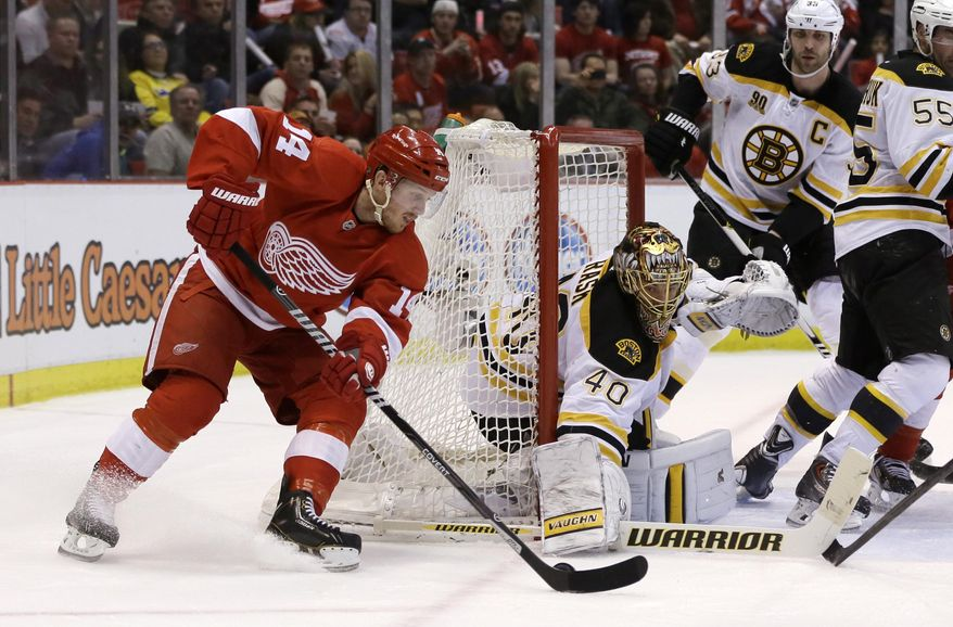 Boston Bruins goalie Tuukka Rask (40) of Finland, stops a goal attempt by Detroit Red Wings center Gustav Nyquist (14) of Sweden, during the second period of Game 3 of a first-round NHL hockey playoff series in Detroit, Tuesday, April 22, 2014. (AP Photo/Carlos Osorio)