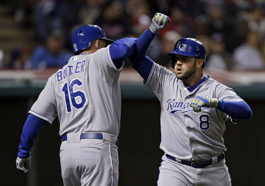 Kansas City Royals' Mike Moustakas (8) celebrates his three-run home run with Billy Butler in the third inning of a baseball game against the Cleveland Indians on Tuesday, April 22, 2014, in Cleveland. (AP Photo/Mark Duncan)