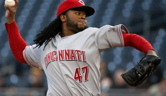 Cincinnati Reds starting pitcher Johnny Cueto delivers during the first inning of a baseball game against the Pittsburgh Pirates in Pittsburgh Tuesday, April 22, 2014. (AP Photo/Gene J. Puskar)