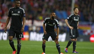 Chelsea players from left: John Obi Mikel, Ashley Cole and Frank Lampard line up during the Champions League semifinal first leg soccer match between Atletico Madrid and Chelsea at the Vicente Calderon stadium in Madrid, Spain, Tuesday, April 22, 2014. (AP Photo/Andres Kudacki)