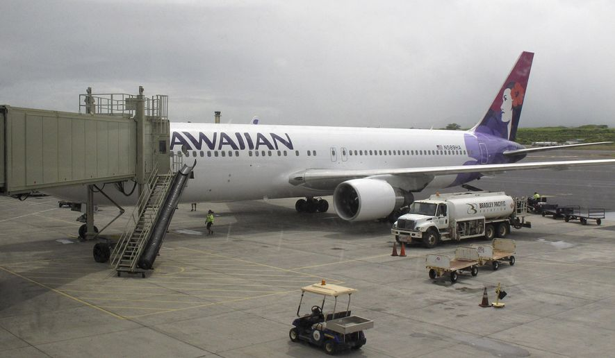 Hawaiian Airlines Flight 45 arrives from San Jose, Calif., in Kahului Airport in Kahului, Hawaii, on April 21, 2014. (Associated Press) **FILE**