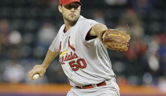 St. Louis Cardinals' Adam Wainwright delivers a pitch during the first inning of a baseball game against the New York Mets Tuesday, April 22, 2014, in New York. (AP Photo/Frank Franklin II)