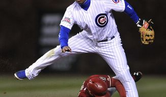 Chicago Cubs second baseman Luis Valbuena watches his throw to first base after forcing out Arizona Diamondbacks' Chris Owings (16), at second base during the third inning of a baseball game in Chicago, Tuesday, April 22, 2014. (AP Photo/Paul Beaty)