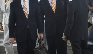 Tennessee men's basketball coach Donnie Tyndall, center, talks to athletic director Dave Hart after Tyndall arrived Tuesday, April 22, 2014, in Knoxville, Tenn. At left are Tyndall's fiancee, Nikki Young, and Tennessee chancellor Jimmy Cheek. The former Southern Mississippi coach succeeds Cuonzo Martin, who resigned last week to take the coaching job at California. (AP Photo/Knoxville News Sentinel, Paul Efird)