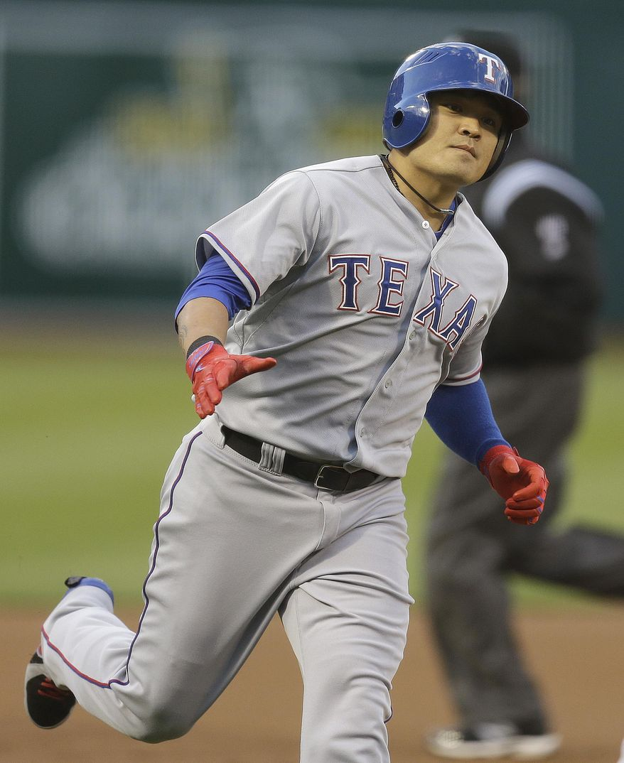Texas Rangers' Shin-Soo Choo of Korea runs the bases after hitting a home run off Oakland Athletics' Dan Straily in the first inning of a baseball game Monday, April 21, 2014, in Oakland, Calif. (AP Photo/Ben Margot)