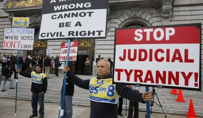 Victor Choban (left) of Sacramento, Calif., and Richard Otterstad (right) of Oakland, Calif., hold up signs outside San Francisco City Hall as a few same-sex couples begin lining up on Thursday, Aug. 12, 2010, in hopes of being married. (Associated Press)