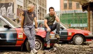 "This image released by Paramount Pictures shows director Michael Bay, left, with Mark Wahlberg on the set of ""Transformers: Age of Extinction."" (AP Photo/Paramount Pictures, Andrew Cooper)"