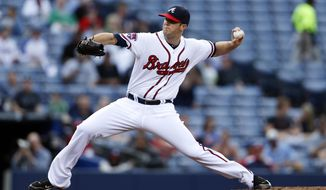 Atlanta Braves pitcher Alex Wood (40) works in the first inning of a baseball game against the Miami Marlins Tuesday, April 22, 2014 in Atlanta.  (AP Photo/John Bazemore)