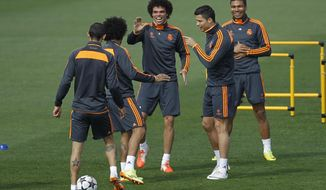 Real's Cristiano Ronaldo, second right, gestures next to Pepe, center, and teammates during a training session in Madrid, Spain, Tuesday, April 22, 2014. Real Madrid will face Bayern Munich in a first leg semifinal Champions League soccer match on Wednesday. (AP Photo/Gabriel Pecot)