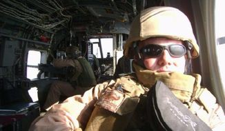 Navy Cmdr. Steven Dundas in a USMC CH-46 during the deployment of 2007-08.