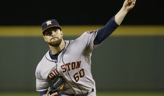 Houston Astros starting pitcher Dallas Keuchel throws during the fourth inning of a baseball game against the Seattle Mariners Monday, April 21, 2014, in Seattle. (AP Photo/Ted S. Warren)