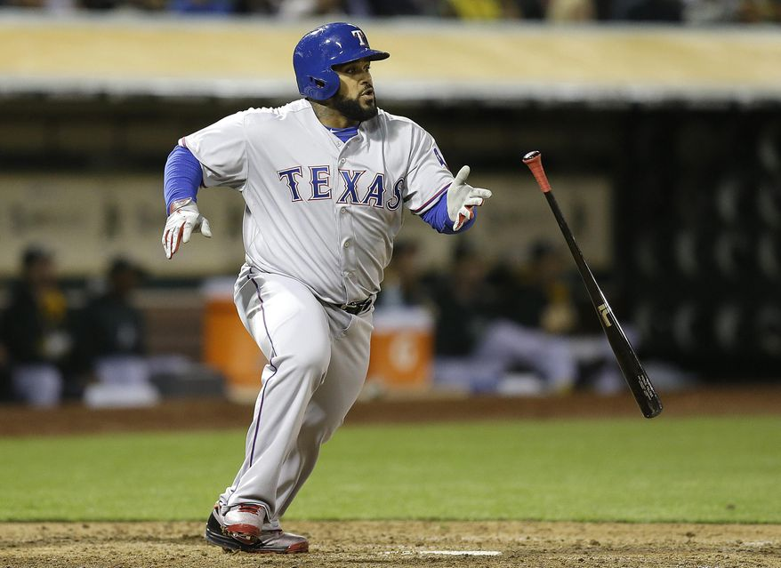 Texas Rangers' Prince Fielder drops his bat after hitting an RBI single off Oakland Athletics' Dan Straily in the fifth inning of a baseball game Monday, April 21, 2014, in Oakland, Calif. (AP Photo/Ben Margot)