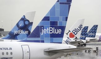 JetBlue airplanes at their gates at John F. Kennedy Airport in New York, Wednesday, Nov. 27, 2013. (AP Photo/Seth Wenig)
