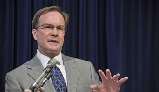 Michigan Attorney General Bill Schuette speaks about the United States Supreme Court's decision, Tuesday, April 22, 2014, regarding the state's Affirmative Action law involving college admissions, during a news conference in Lansing, Mich. (AP Photo/The Detroit News, Dale G. Young) DETROIT FREE PRESS OUT; HUFFINGTON POST OUT.