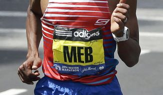 Meb Keflezighi, of San Diego, Calif., runs during the 118th Boston Marathon with the names of those killed in the 2013 bombings, and the MIT officer allegedly slain by the bombing suspects, on his bib, Monday, April 21, 2014, in Boston. Martin Richard, Krystle Campbell and Lu Lingzi, were killed in the bombings, while MIT officer Sean Collier was allegedly shot to death by the bombing suspects. (AP Photo/Steven Senne)
