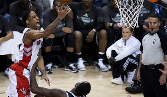 Toronto Raptors guard DeMar DeRozan, left, drives over Brooklyn Nets forward Andray Blatche to score during the second half of Game 2 in an NBA basketball first-round playoff series, Tuesday, April 22, 2014, in Toronto. (AP Photo/The Canadian Press, Nathan Denette)