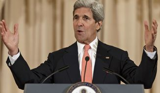 Secretary of State John Kerry announces the launch of second Quadrennial Diplomacy and Development Review during a speech at the State Department in Washington, Tuesday, April 22, 2014.  (AP Photo/J. Scott Applewhite)