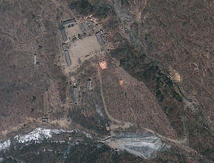 This April 18, 2012 satellite image provided by GeoEye shows North Korea's Punggye-ri nuclear test site. Commercial satellite imagery shows increased activity at North Korea's nuclear test site but not enough to indicate an underground atomic explosion is imminent, a U.S. research institute said Tuesday. North Korea last month threatened to conduct its fourth nuclear test and there's been speculation it may do so as President Barack Obama travels to Asia this week. (AP Photo/GeoEye)