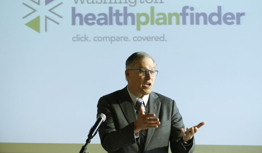 Washington Gov. Jay Inslee speaks at an event Wednesday, April 23, 2014 in Seattle to highlight the success of the Washington state healthcare exchange in getting hundreds of thousands of people into new health coverage, including about 450,000 who obtained new Medicaid coverage. (AP Photo/Ted S. Warren)