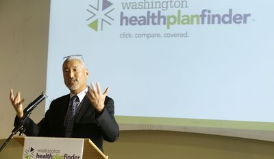 Richard Onizuka, CEO of the Washington Health Benefit Exchange, speaks at an event Wednesday, April 23, 2014 in Seattle to highlight the success of the Washington state healthcare exchange in getting hundreds of thousands of people into new health coverage, including about 450,000 who obtained new Medicaid coverage. (AP Photo/Ted S. Warren)