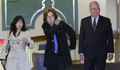 Former Illinois State University President Timothy Flanagan and his wife, Nancy, walk through the lobby of the McLean County Law and Justice Center in Bloomington, Ill., with his attorney Stephanie Wong, left, after he pleaded not guilty to a disorderly conduct charge Wednesday, April 23, 2014. The charge stems from an alleged altercation between Flanagan and a grounds crew worker outside of the university-owned presidents' residence on Dec. 5. Flanagan has acknowledged yelling at the employee but denies he spat on or made contact with the man.  (AP Photo/The Pantagraph, Lori Ann Cook-Neisler)