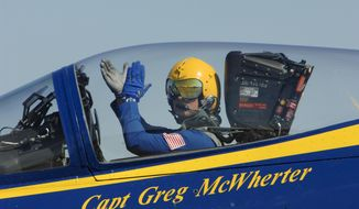 In this Sept. 10, 2011 photo provided by the U.S. Navy, Capt. Greg McWherter, commanding officer and flight leader of the U.S. Navy flight demonstration squadron, the Blue Angels, responds to the crowd at the Guardians of Freedom Air Show in Lincoln, Neb. The U.S. Navy says McWherter has been relieved of duty over misconduct while he was commanding officer of the Blue Angels. McWherter allegedly allowed and in some cases encouraged sexually explicit humor, lewd speech and inappropriate comments among the famed precision flying team. McWherter's most recent post was as executive officer of Naval Base Coronado. (AP Photo/U.S. Navy, Jen Blake)