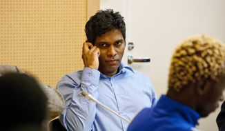 "FILE - A June 22, 2011 photo from files showing Singaporean, Wilson Maj Perumal, sitting in the Lapland district court in Rovaniemi, Finland. Police say they arrested convicted match-fixer Wilson Raj Perumal of Singapore on an international warrant last week in Finland, where he was given a two-year prison sentence in 2011 for bribing football players in the Finnish league. Detective Superintendent Jari Nieminen of the National Bureau of Investigation said on Wednesday, April 23, 2014, that officers were examining the warrant, but declined to give any more information. After his 2011 arrest in Finland, Perumal stunned European investigators with rare and invaluable details on international match-fixing and bribing, entailing hundreds of games and millions of euros. He claimed to have paid off footballers in Syria and Africa and fixed games in the United States. Perumal served a year of his sentence in Finland before extradition to Hungary, where he was a ""controlled informant"" under house arrest. (AP Photo/Lehtikuva, Kaisa Siren, File)   FINLAND OUT"