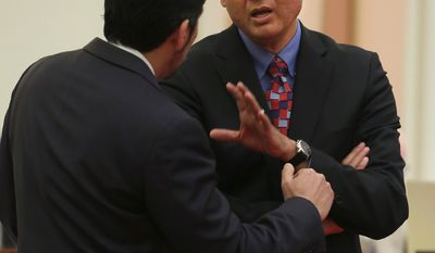 Sen. Ed Hernandez, D-Covina. right, talks with Sen. Kevin de Leon, D-Los Angeles at the Capitol in Sacramento, Calif., Monday, April 21, 2014. Hernandez proposed a constitutional amendment that would ask voters to again allow public colleges to use race and ethnicity when considering college applicants.  The proposal stalled this year after backlash from Asian Americans.(AP Photo/Rich Pedroncelli