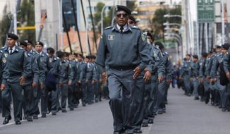 Army soldiers march on the second day of protests in La Paz, Bolivia, Wednesday, April 23, 2014. Hundreds of low ranking soldiers from Bolivia's Armed Forces marched for a second day against the military high command's dismissal of four of its leaders who defended their call for more career opportunities. The Ministry of Defense has threatened to discharge the soldiers who continue to protest. (AP Photo/Juan Karita)