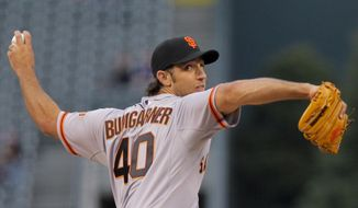 San Francisco Giants starting pitcher Madison Bumgarner throws during the first inning of a baseball game, Tuesday, April 22, 2014, in Denver. (AP Photo/Barry Gutierrez)