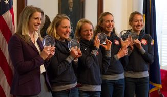Members of the United States Olympic Team who represented Vermont at the 2014 Sochi Winter Games, from left, Hannah Kearney, Ida Sargent, Liz Stephen, Susan Dunklee and Sophie Caldwell, pose for a photo as they were honored at the Vermont Statehouse Wednesday, April 23, 2014, in Montpellier, Vt.  (AP Photo/The Times Argus, Jennifer Langille)