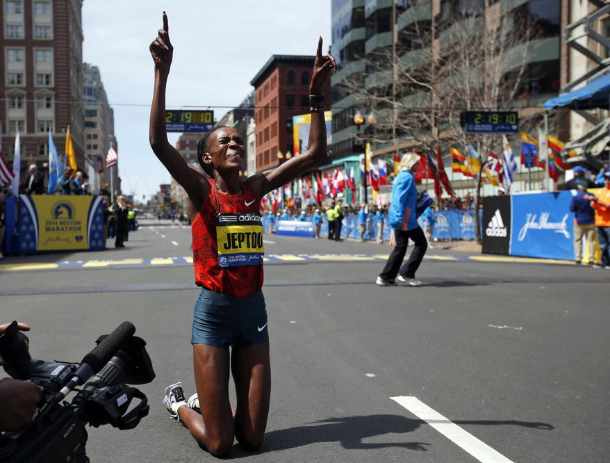 10ThingstoSeeSports - Rita Jeptoo, of Kenya, celebrates her win in the women's division of the 118th Boston Marathon, Monday, April 21, 2014, in Boston. (AP Photo/Elise Amendola, File)