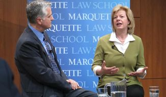 U.S. Sen. Tammy Baldwin, D-Wis., right, takes questions from moderator Mike Gousha at a discussion Wednesday, April 23, 2014, at Marquette University in Milwaukee. Baldwin touted the successes of the new federal health care and encouraged fellow Democrats to do the same. (AP Photo/Ramde Dinesh)