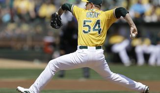 Oakland Athletics' Sonny Gray works against the Texas Rangers in the first inning of a baseball game Wednesday, April 23, 2014, in Oakland, Calif. (AP Photo/Ben Margot)