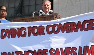 State Sen. Ben Nevers, D-Bogalusa, talks about his Medicaid expansion bill at a rally on Wednesday, April 23, 2014, in Baton Rouge, La. Nevers said Louisiana's voters should decide whether to offer free health insurance to thousands of working poor in the state. (AP Photo/Melinda Deslatte)