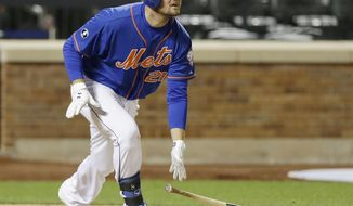 New York Mets' Lucas Duda follows through on a home run during the sixth inning of a baseball game against the St. Louis Cardinals, Wednesday, April 23, 2014, in New York. (AP Photo/Frank Franklin II)
