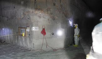 This April 2, 2014, image provided by the  U.S. Department of Energy shows workers underground inside the Waste Isolation Pilot Plant facility in Carlsbad, N.M., for the first time since the Feb. 14 radiological release. The operators of this federal government's troubled nuclear waste dump are bracing for a scathing report Wednesday, April 23, 2014, on their response to a radiation release that contaminated 21 workers and shuttered the southeastern New Mexico facility two months ago. (AP Photo/U.S. Department of Energy)