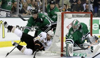Anaheim Ducks right wing Kyle Palmieri (21) attempts a wrap-around shot from the ice as Dallas Stars' Kevin Connauton (23) helps goalie Kari Lehtonen (32) of Finland against the shot in the second period of Game 4 of a first-round NHL hockey Stanley Cup playoff series, Wednesday, April 23, 2014, in Dallas. (AP Photo/Tony Gutierrez)