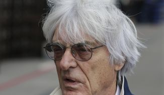FILE - In this Nov. 14, 2013 file picture  President and CEO of Formula One Management Bernie Ecclestone arrives at the Circuit of the Americas for the Formula One U.S. Grand Prix auto race, in Austin, Texas. Ecclestone goes on trial in Munich on Thursday, April 24, 2014, on bribery charges that could put him in prison for up to 10 years if convicted. The trial could spell the end of the 83-year-old Ecclestone's career in the racing series that has become a lucrative business under his guidance. (AP Photo/Darron Cummings, File)