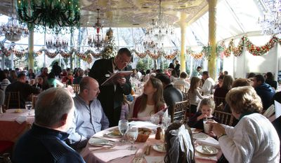 FILE - In this Dec. 29, 2009 file photo, a waiter takes an order for a family having lunch in the Crystal Room at the at Tavern on the Green restaurant in New York, which was scheduled to serve its last meal two days later. The once grand restaurant in Central Park is reopening Thursday, April 24, 2014 after being closed since the operators lost their lease and declared bankruptcy in 2009. (AP Photo/Tina Fineberg, File)