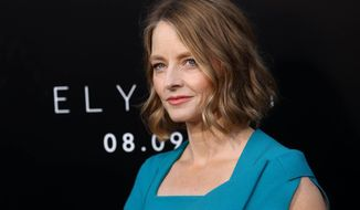"FILE - In this Aug. 7, 2013 file photo, Jodie Foster arrives at the world premiere of ""Elysium"" at the Regency Village Theater, in Los Angeles. A representative for the Oscar-winning actress confirms that Foster wed girlfriend Alexandra Hedison over the weekend. Publicist Jennifer Allen offered no other details Wednesday, April 23, 2014. (Photo by Matt Sayles/Invision/AP, file)"