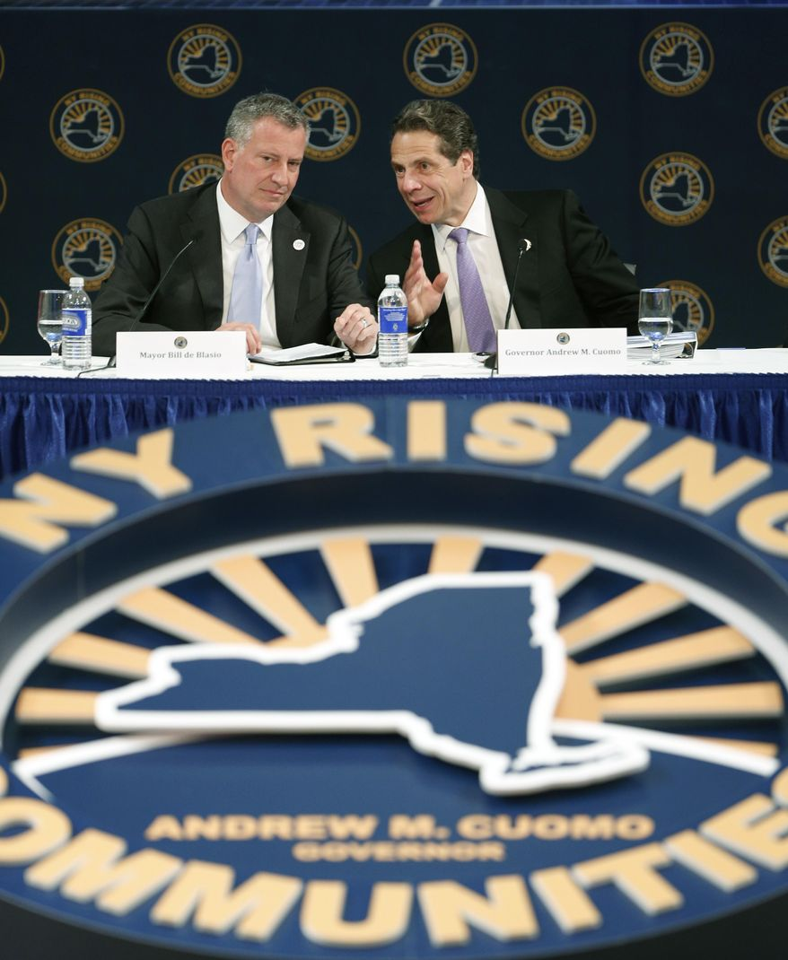 New York City Mayor Bill de Blasio, left, and New York Gov. Andrew Cuomo talk during the NY Rising Spring Conference on Wednesday, April 23, 2014, in Albany, N.Y. (AP Photo/Mike Groll)