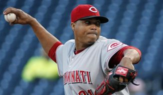 Cincinnati Reds starting pitcher Alfredo Simon delivers during the first inning of a baseball game against the Pittsburgh Pirates in Pittsburgh on Wednesday, April 23, 2014. (AP Photo/Gene J. Puskar)